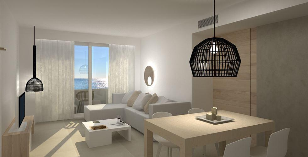 Impressie van de living in een van de suites met uitzicht op zee