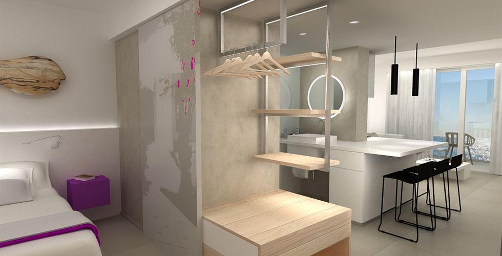 Het slaapgedeelte/badkamer gedeelte in een van de suites van het hotel